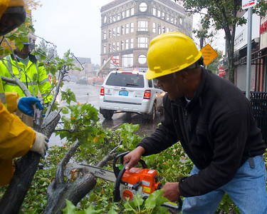 102912, Boston, MA - A DPW crew from District 10 cut up and dispose of a tree blocking Washington Street that was brought down by Hurricane Sandy's winds. Photo by Ryan Hutton