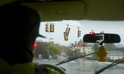 102912, Boston, MA - DPW  Districts 10 and 2 Supervisor Darrell Kaiser, 38, calls in traffic lights at the intersection of Martin Luther King Boulevard and Humboldt Avenue which were in danger of falling. Photo by Ryan Hutton