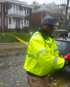 102912, Boston, MA - DPW  Districts 10 and 2 Supervisor Darrell Kaiser, 38, blocks off  Ruthven Street to traffic due to a tree brought down by Hurricane Sandy. Photo by Ryan Hutton