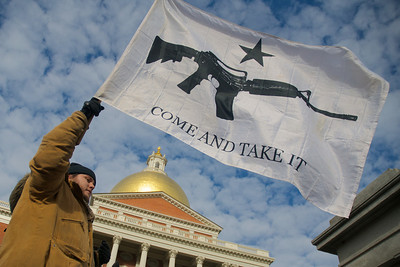 "011913, Boston, MA - A man who wished to be identified only as Nick M. of Boston, shows his feelings on gun control at the ""Guns Across America"" rally outside the Massachusetts statehouse to protest any future gun control legislation. Photo by Ryan Hutton"