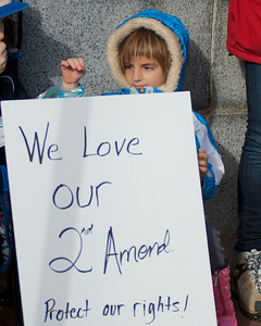 "011913, Boston, MA -Anna Deveno, 6, of Bellingham came with her mother Amanda to the ""Guns Across America"" rally outside the Massachusetts statehouse to protest any future gun control legislation. Photo by Ryan Hutton"