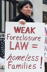 06052012, Boston, MA - Alma Hernandez protests with members of NEW ROAD (New England Workers and Residents Organizing Against Displacement) on the steps of the Statehouse that the new foreclosure prevention measures being voted on tomorrow don't go far enough. Alma is facing foreclosure from her Somerville home. Herald photo by Ryan Hutton