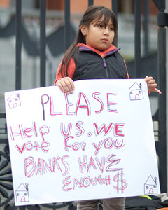 06052012, Boston, MA - Daniela Hernandez, 8, protests with members of NEW ROAD (New England Workers and Residents Organizing Against Displacement) on the steps of the Statehouse that the new foreclosure prevention measures being voted on tomorrow don't go far enough. Daniela and her father Marlon are facing foreclosure from their Malden home. Herald photo by Ryan Hutton