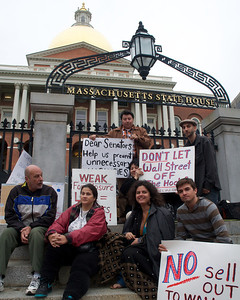 06052012, Boston, MA - Members of the NEW ROAD (New England Workers and Residents Organizing Against Displacement) protest on the steps of the Statehouse that the new foreclosure prevention measures being voted on tomorrow don't go far enough. Herald photo by Ryan Hutton