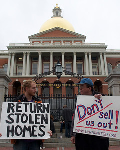 06052012, Boston, MA - Michael Frederiksen, left, and Chris Horton, right, protest with members of NEW ROAD (New England Workers and Residents Organizing Against Displacement) on the steps of the Statehouse that the new foreclosure prevention measures being voted on tomorrow don't go far enough. Herald photo by Ryan Hutton