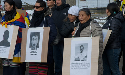 031013, Boston, MA - Free Tibet activists wear posters of the 101 Tibetans who have self-immolated in protest against the Chinese occupation. Several hundred activists marched and chanted around Boston Common as part of the Tibetan National Uprising Day protests. Herald photo by Ryan Hutton 031013, Boston, MA - Free Tibet activists wear posters of the 101 Tibetans who have self-immolated in protest against the Chinese occupation. Several hundred activists marched and chanted around Boston Common as part of the Tibetan National Uprising Day protests. Herald photo by Ryan Hutton