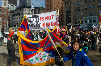 031013, Boston, MA - Several hundred activists march around Boston Common as part of the Tibetan National Uprising Day protests. Herald photo by Ryan Hutton