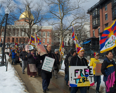 031013, Boston, MA - Several hundred activists march from the steps of the statehouse to Boston Common as part of the Tibetan National Uprising Day protests. Herald photo by Ryan Hutton
