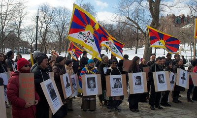 031013, Boston, MA - Free Tibet activists wear posters of the 101 Tibetans who have self-immolated in protest against the Chinese occupation. Several hundred activists marched and chanted around Boston Common as part of the Tibetan National Uprising Day protests. Herald photo by Ryan Hutton