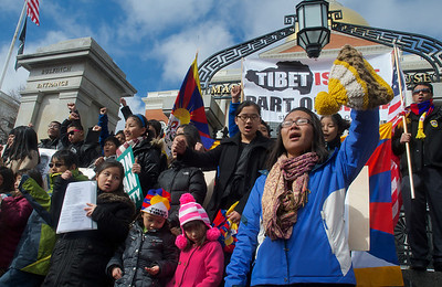 031013, Boston, MA - Tenzin Yangchen Nangpa, right foreground, general secretary of the Tibetan Association of Boston, chants along with a ground of several hundred others on the steps of the statehouse as part of the Tibetan National Uprising Day protests. Herald photo by Ryan Hutton