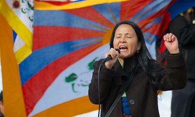 031013, Boston, MA - Yonten Chodon leads several hundred activists in chanting at Boston Common as part of the Tibetan National Uprising Day protests. Herald photo by Ryan Hutton