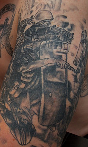 102512, Plainville, MA - US Army veteran Brian Parker shows off one of his many military themed tattoos. Herald photo by Ryan Hutton