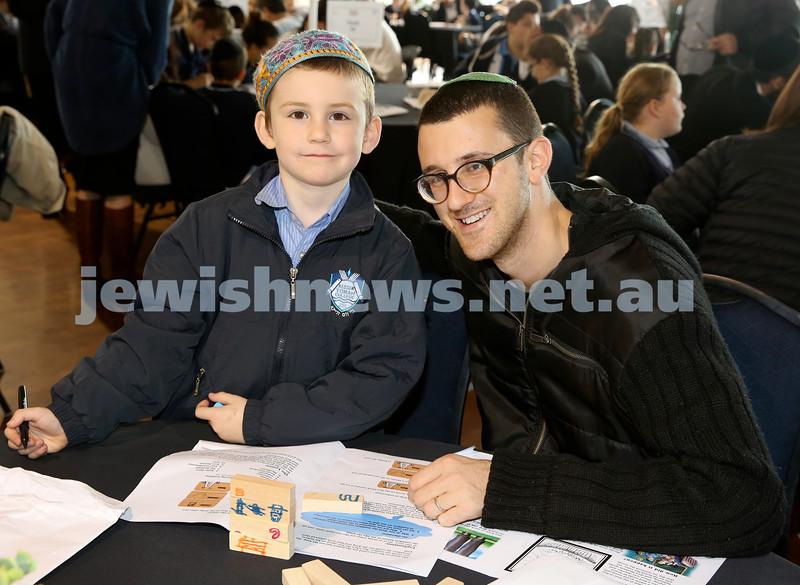 Generation Sinai learning at Kesser Torah College. Elchanan Kucher with his dad Ari.