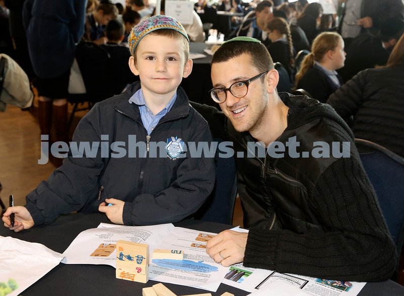 Generation Sinai learning at Kesser Torah College. Elchanan Kucher with his dad Ari.