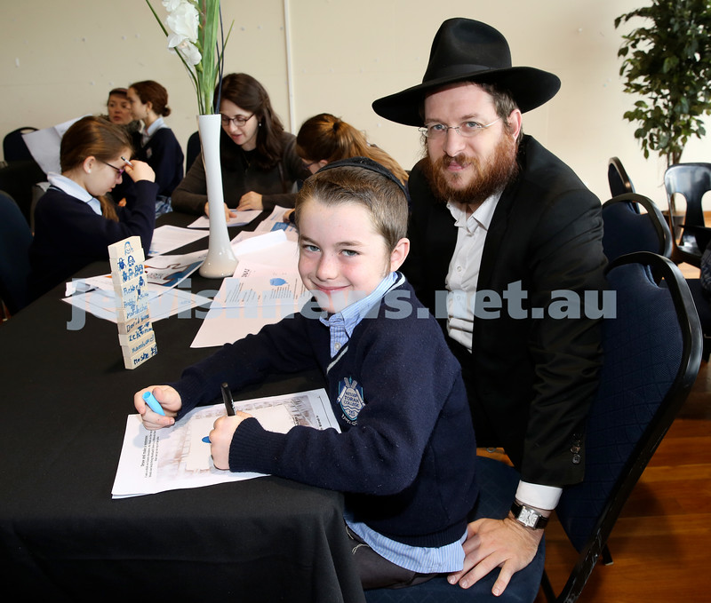 Generation Sinai learning at Kesser Torah College. Mendel Moss with his dad Rabbi Aaron Moss.