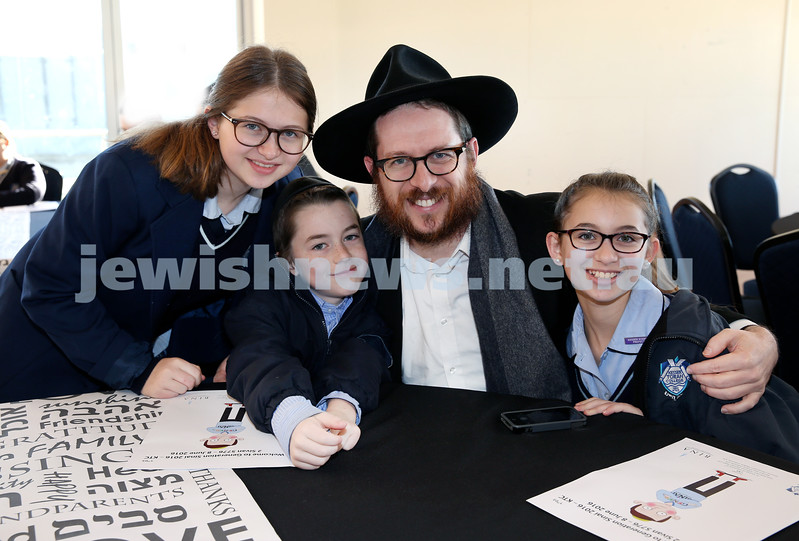 Generation Sinai held at Kesser Torah College. Rabbi Aron Moss with his children (from left) Bluma, Mendel, Batya. Pic Noel Kessel.