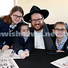 Generation Sinai held at Kesser Torah College. Rabbi Aron Moss with his children (from left) Bluma, Mendel, Batya. Pic Noel Kessel.