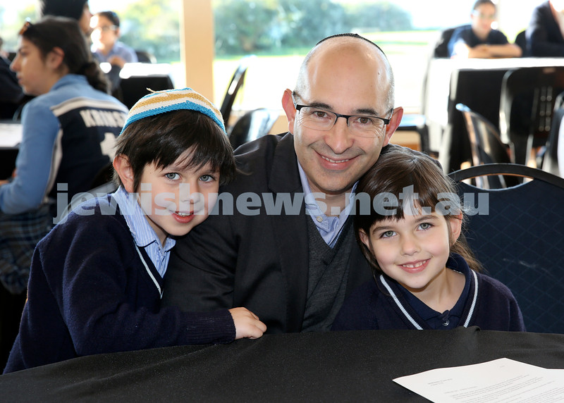 Generation Sinai held at Kesser Torah College. Howard Leibman with his children Jacob (left) and Elli. Pic Noel Kessel.