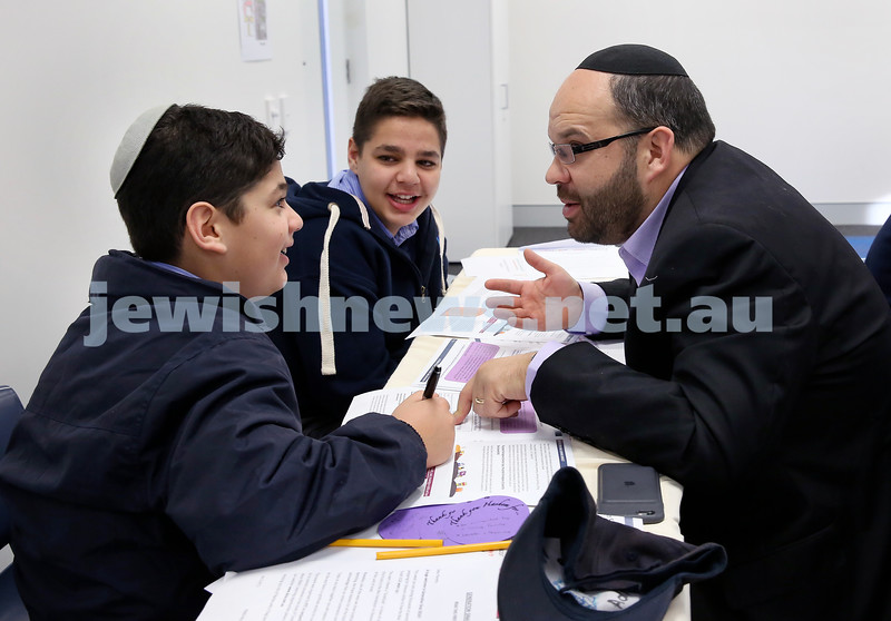 Generation Sinai held at Kesser Torah College. Adiel (left) & Yoni Goldberg learn with their dad Michael. Pic Noel Kessel.