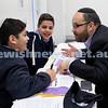 Generation Sinai held at Kesser Torah College. Adiel (left) & Yoni Goldberg learn with their dad Michael. Pic Noel Kessel.