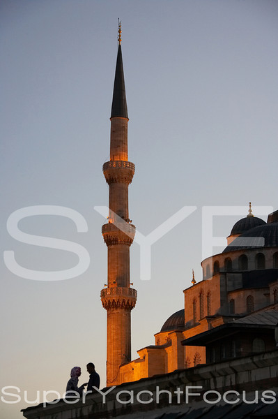 Minaret with couple at dusk