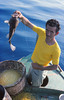 Greek fisherman with grouper