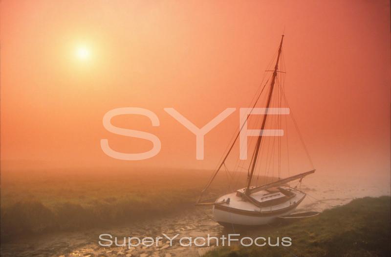 Sailing boat in fog