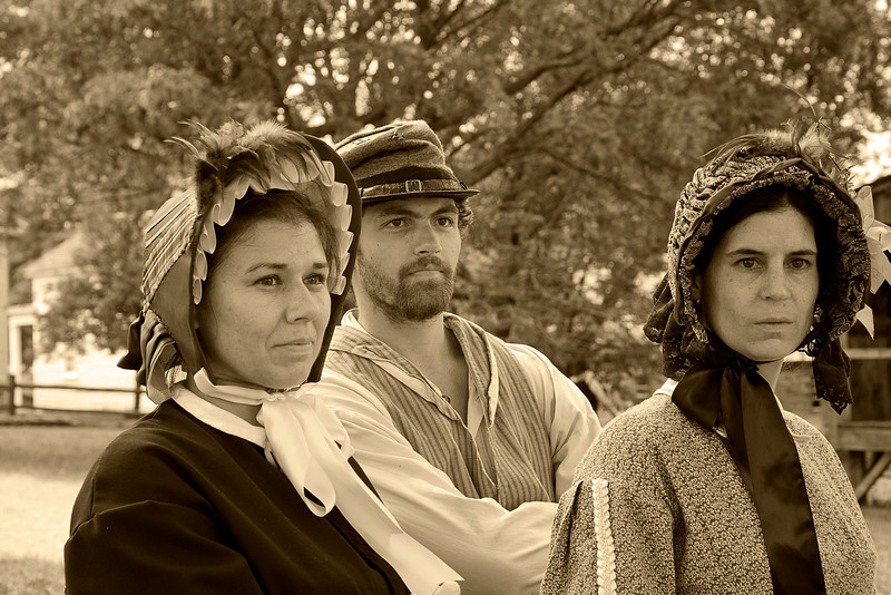 Civil War Re-Enactment at Genesee Country Villages Museum, July 18, 2010.  Look of Sepia.  A process used by old photographers to add long life to their images by converting silver to silver sulfide.  This makes the image look a little red.