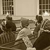 Period dress volunteers inside church, HDR