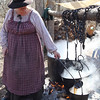 Syrup maker shows the Maple syrup in the final kettle. finger lakes, 2009