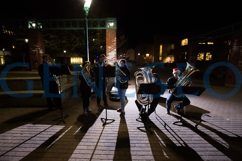 Members of the Geneseo Low Brass Ensemble host an impromptu holiday rehearsal outside of the ISC.