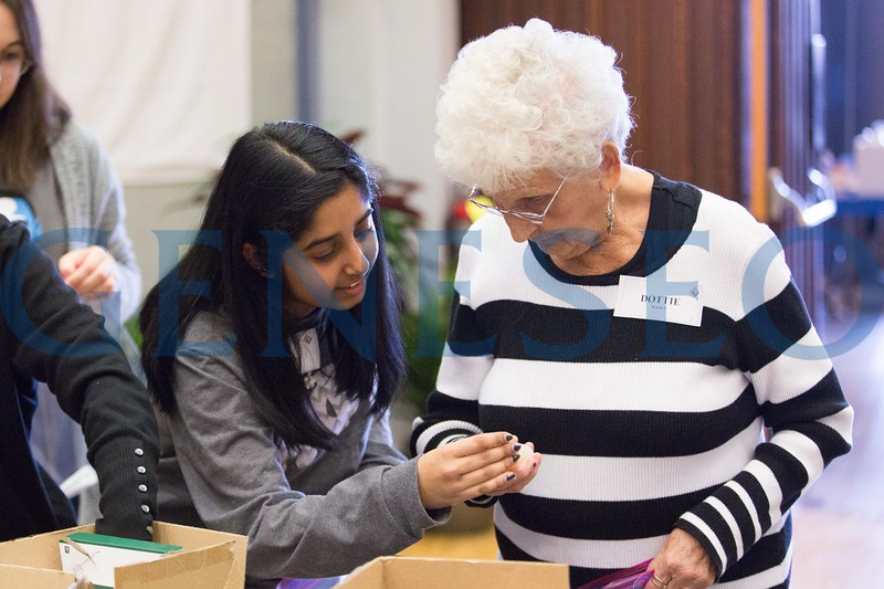 Neha Marolia '18 working with Dottie Manes of Avon, NY