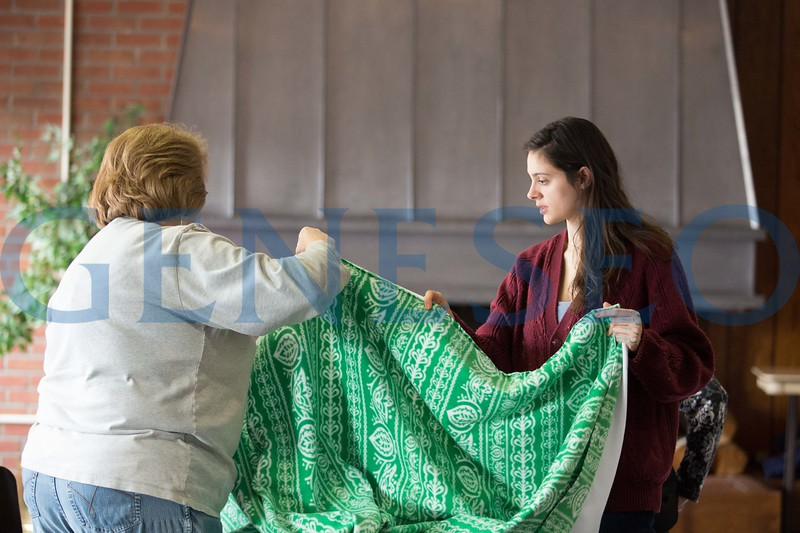 Tess Ramos-Dries (right) '18 making blankets for VA center