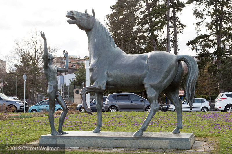 Bronze statue of a horse and nude figure