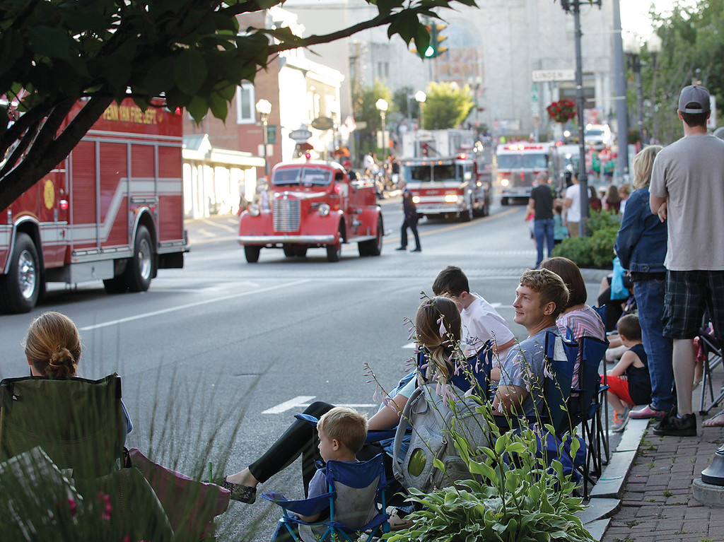 Spencer Tulis/Finger Lakes Times<br /> Large crowds lined the streets of downtown Geneva Saturday evening for the annual Fireman's Parade. Participants, of which there were also many, and those looking on experienced pleasant temperatures and sunny skies. Seneca Street was one of dozens of ideal viewing spots.