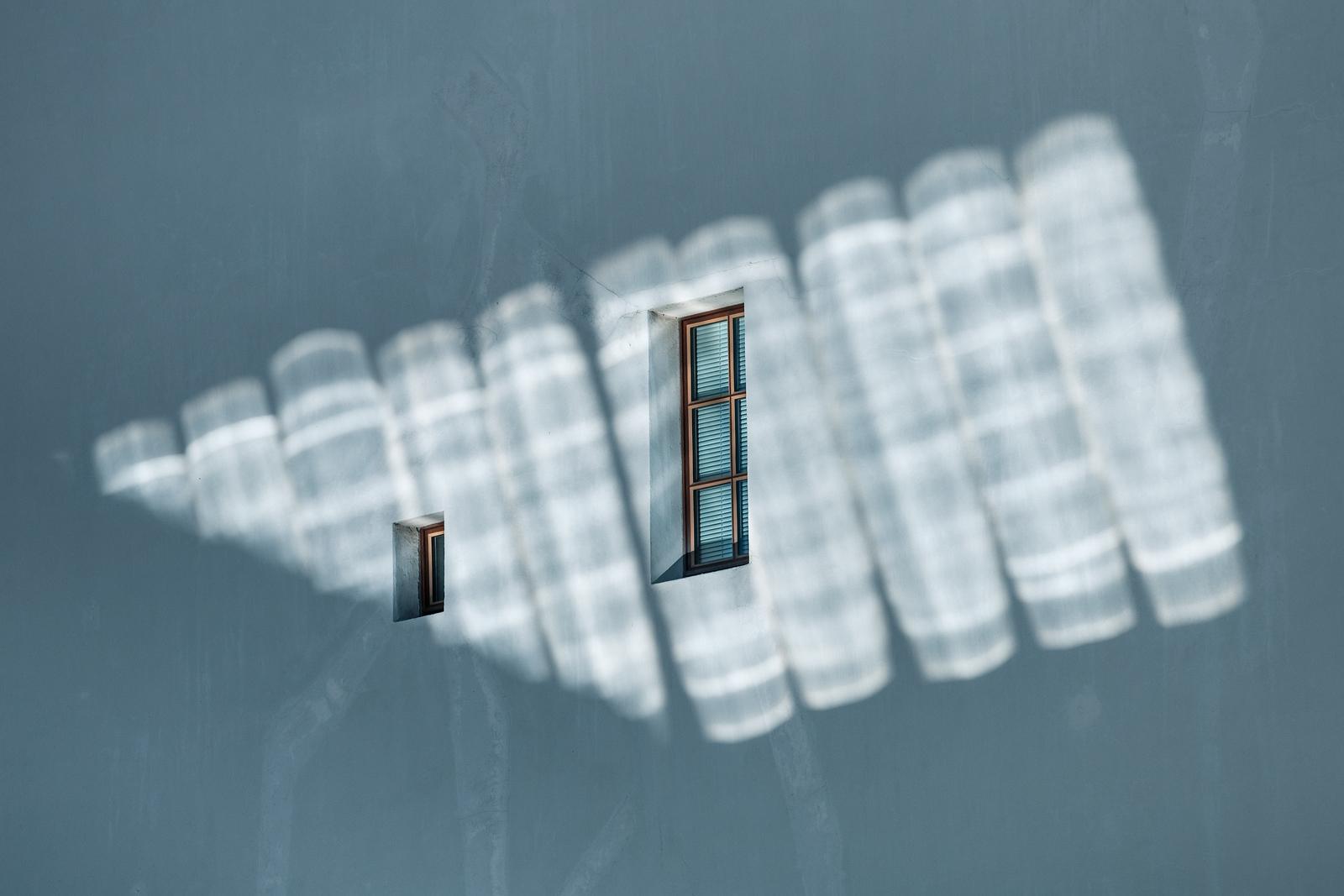 Reflected sunglight on windows above the palais de justice of Geneva