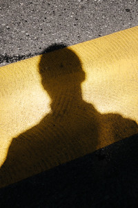 Shadow on a street crossing