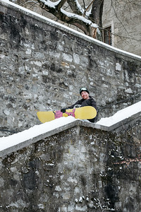 A snowboarder in Geneva old town
