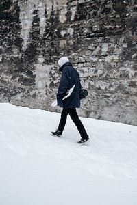 Skater walking in the snow