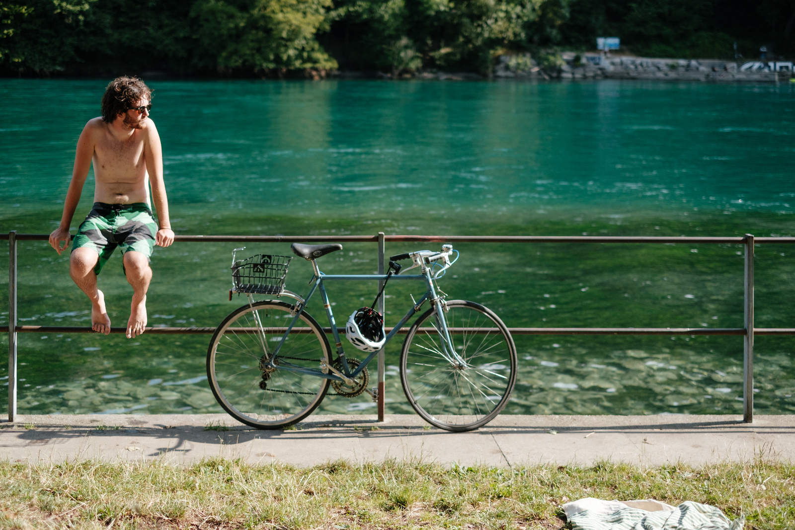 A guy enjoying the summer at the pointe de la jonction Geneva