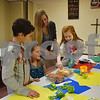 Katrina J. E. Milton - kmilton@shawmedia.com<br /> On Jan. 22, more than 20 people attended the first free family cooking class at Genoa Faith United Methodist Church, 325 S. Stott St. in Genoa. Pictured (from left) are CJ Rogers, 9, Alyssa Frisella, 9, Krystal Fulton and Mia Peck, 6, all of Genoa.