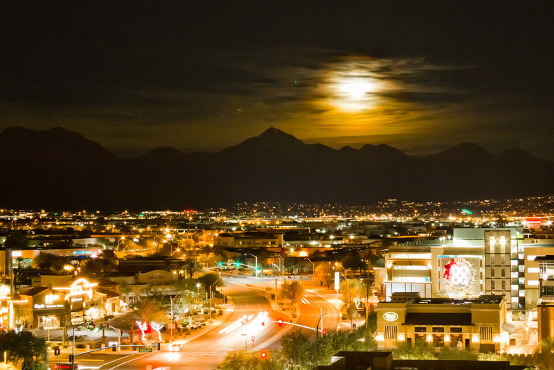 Obscured and Waning Full Moon Over McDowell Mountains, Scottsdale Arizona. Viewed from Kierland Xmas Eve 2010.