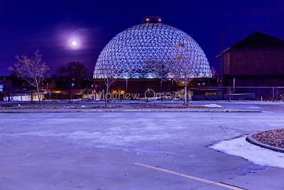 Desert dome at Henry Doorly Zoo Omaha Nebraska at night with the moon