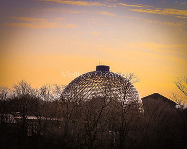 Desert dome at Henry Doorly Zoo at dusk with sunset skyline.