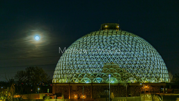 Desert dome at Henry Doorly Zoo Omaha Nebraska at night with the moon