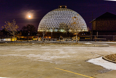 Desert dome at Henry Doorly Zoo at night with the moon.