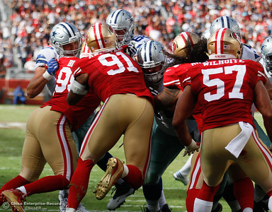 Geoff Swaim, tight end for the Dallas Cowboys works to stop 49er players from advancing towards the quarterback Sunday October 2, 2016 at Levi's Stadium in Santa Clara, California. Emily Bertolino -- Enterprise-Record