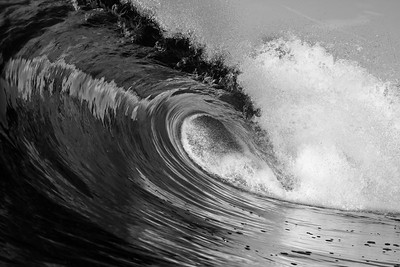 Black and White Sharpness reflect the glassy sunrise off exploding whitewater in Laguna Beach