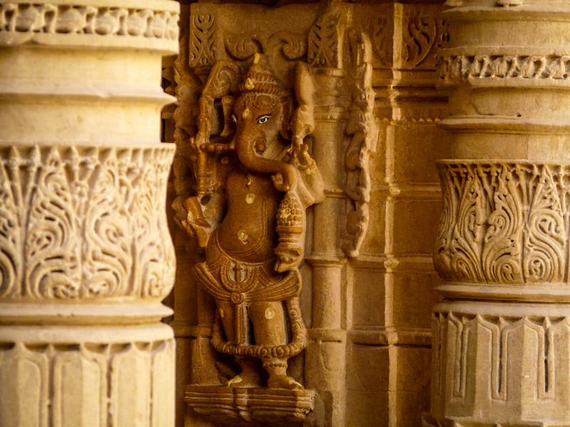Ganesh against the temple pillars, Jain Temple, Jaisalmer, India