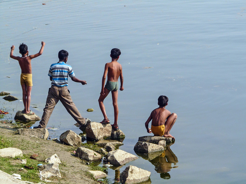 Kids Fishing For Coins With Magnets, Varanasi